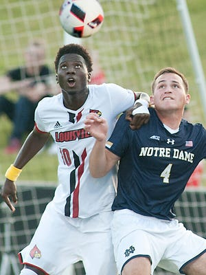 Louisville Cardinals forward Mohamed Thiaw who scored the only Louisville goal to beat then #1 ranked Notre Dame, heads the ball away from Notre Dame defender Matt Habrowski.16 September 2016