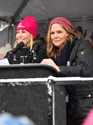 """If you're feeling helpless or feeling dejected, take a look around,"" Chelsea Handler, left, said. ""You're not alone. Don't lose hope. Get your hope. I'll give you hope. Let's all give each other hope and stick together."""