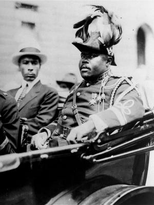 Black nationalist leader Marcus Garvey is shown in a military uniform as the 'Provisional President of Africa' during a parade up Lenox Avenue in Harlem, New York City, in August 1922, during the opening day exercises of the annual Convention of the Negro Peoples of the World.