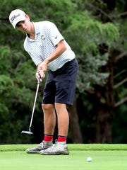 Central Magnet's Lane Counts lines up a putt during the district tournament.
