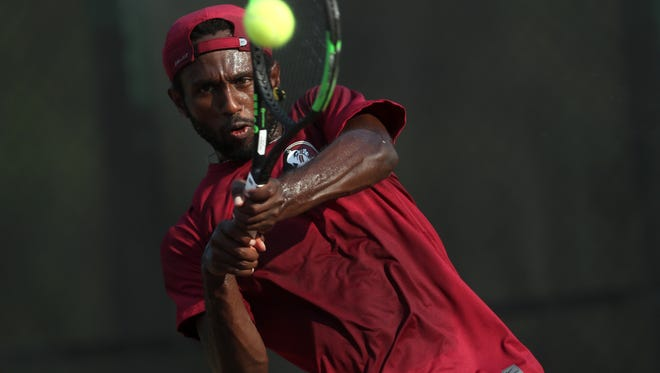 FSU's Guy Iradukunda hits a backhand against Alabama State during the NCAA Tallahassee Regional at the Scott Speicher Tennis Center on Friday May 11, 2018.