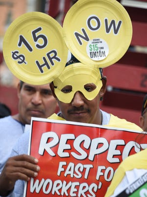 Demonstrators in Los Angeles demand an increase of the minimum wage at a rally in December 2014.