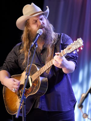 """Chris Stapleton performs during pre-taping for """"Dolly Parton's Smoky Mountains Rise: A Benefit for the My People Fund"""" on Dec. 13, 2016, in Nashville."""