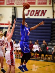 Garden City's Aleea Montgomery (20) goes up for a basket