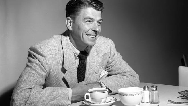 """Ronald Reagan has a cup of coffee while visiting Milwaukee on Aug. 14, 1950, to promote his new movie, """"Louisa."""" This photo was published in the Aug. 14, 1950, edition of The Milwaukee Journal."""