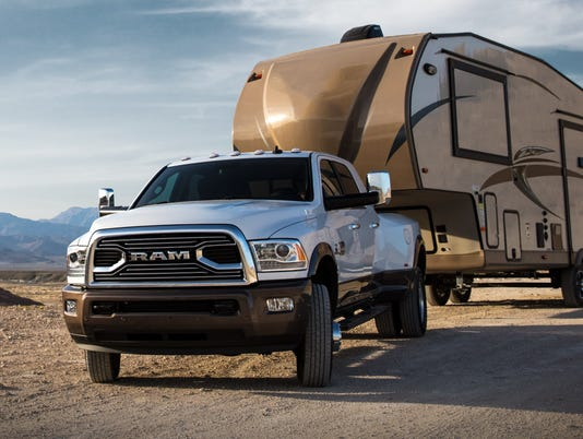 636379788713422278-Ram-3500-Longhorn-with-5th-wheel-travel-trailer.jpg