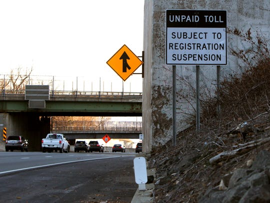 A sign before the electronic toll gantry on the eastbound