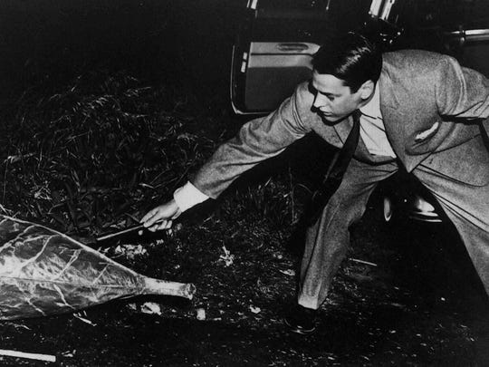 "Miles (Kevin McCarthy) battles  pods from outer space in the 1956 version of ""Invasion of the Body Snatchers."""