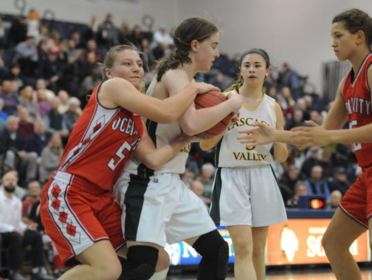 Ocean City's Sadie Ford, left, attempts to steal the