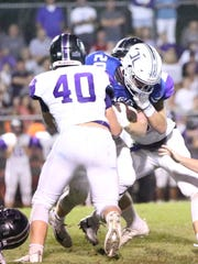 TCA's Addison Coleman goes in for the tackle on Jackson