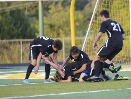 Asheville High soccer players celebrate a goal during a game earlier this season at Reynolds.