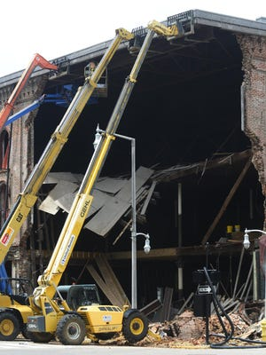 Installing beams to help keep the Webber building from collapsing probably won't save it from demolition..