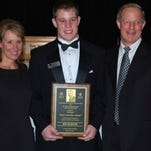 """Shown in March 2012, then La Salle senior linebacker Joe Burger won the National Football Foundation's """"That's My Boy"""" award. With Joe, center, were his parents Felicia and Bob Burger of Monfort Heights."""