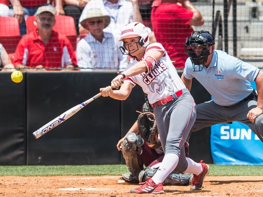 UL second baseman Casidy Chaumont (24) makes contact