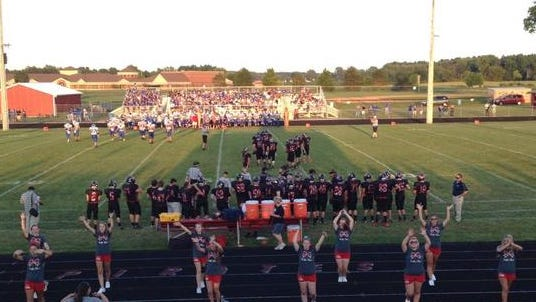 Cheerleaders pump up the crowd during the Cardington-Riverdale game on Friday, Aug. 29, 2014. The Pirates took a commanding lead over the visiting team.