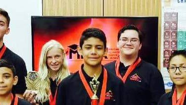 The two-time MESA national champions from Deming High are, back row from left, David Velez, Adrianna Darrow,  Antoni Varela, and Adrian Luna. Pictured in front are the national champs from the middle school division from Chaparral Middle School in Anthony, NM.
