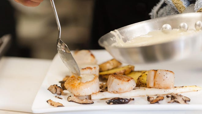 The scallops at Nook Kitchen is served with a buttery, sweet white chocolate vanilla bean cream.
