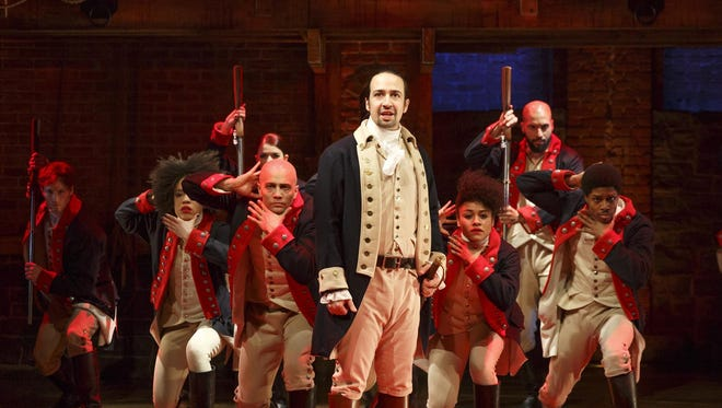 """Lin-Manuel Miranda (center) is the creative force behind """"Hamilton,"""" which received a record 16 Tony nominations."""