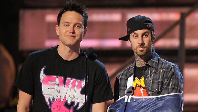 There goes the neighborhood: Blink-182's Mark Hoppus, left, and Travis and  Barker are setting up at Las Vegas' Palms Casino and Resort starting in May.