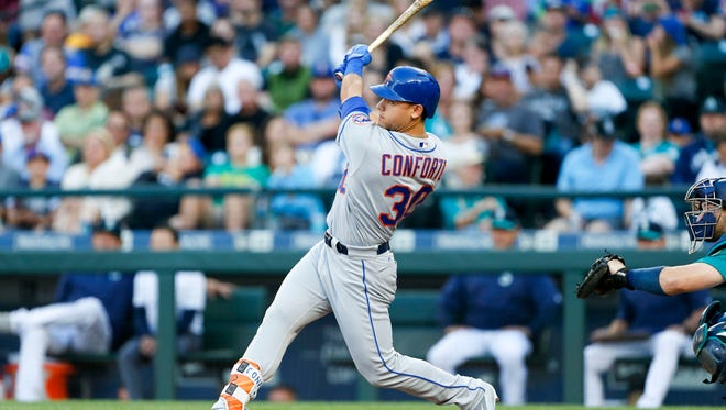 New York Mets center fielder Michael Conforto hit two home runs in the team's 7-5 victory over Seattle at Safeco Field on Friday.