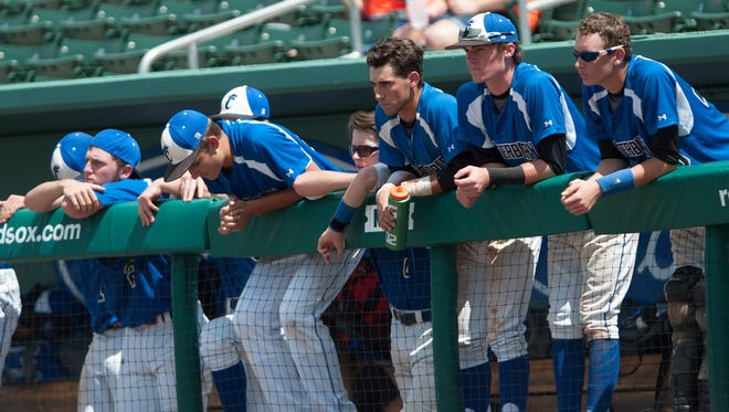 Members of the Canterbury School baseball team react to losing to Westminster Christian School in the 3A semifinal game.  The score was 4-2.