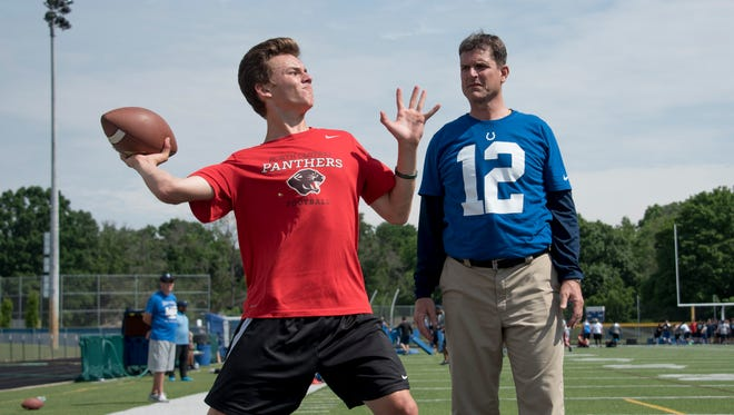 Jim Harbaugh wore an Andrew Luck jersey at his June 1 camp stop in Indianapolis.