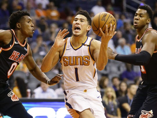Suns guard Devin Booker drives to the basket against the Heat on Nov. 8.