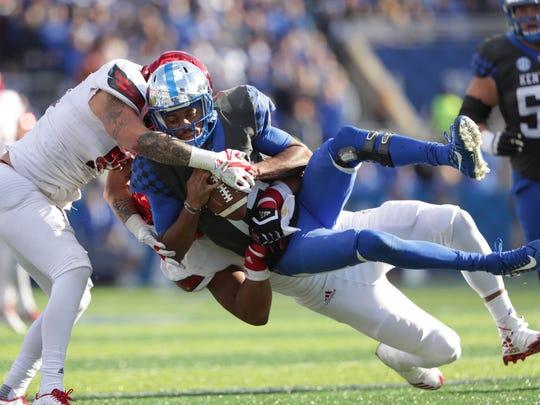 Louisville's Trevon Young wraps up Kentucky quarterback Stephen Johnson for a loss. Nov. 24, 2017.