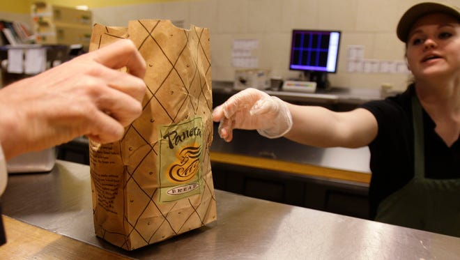 Krista Johnson passes an order to a customer at a Panera store in Brookline, Massachusetts, on March 8, 2010.  The Missouri company says all the items on its kids' menu are free of artificial flavors, preservatives, sweeteners and colors.