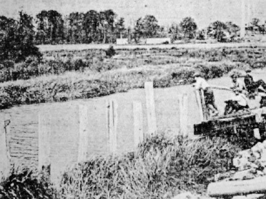 1916- At this psot in Matawan Creek, in Matawan, New Jersey, Lester Stilwell and Stanley Fischer were attacked by a shark. The pilings in the foreground served as diving platforms for Lester and other boys playing in the creek. The dilapidated wharf at the right was where the mortally wounded Fisher was brought ashore........ From a comtemporary news photo