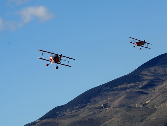 Airplanes make their way around the course during the