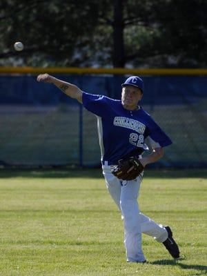 Chillicothe's Dylan Conley throws the ball to the infield during a game against Washington Court House on Tuesday at Chillicothe High School. The Cavaliers defeated the Lions 8-7.