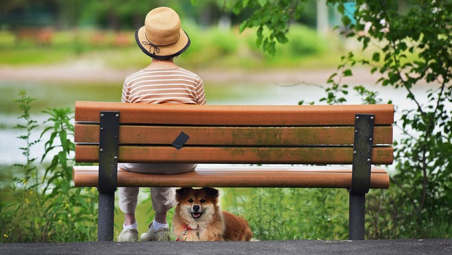 Doris Moore, 92, of Glen Rock, sits on the bench with her great companion Trinket at the Saddle River County Park in Glen Rock on June 13, 2016. The bench she is sitting on was donated to this park in the memory of her husband, Geoffrey Moore, who died on June 1, 2008 at the age of 86.