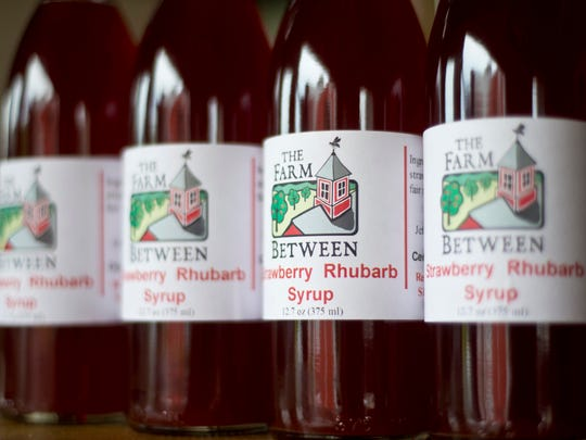 Strawberry rhubarb syrup grown, produced, bottled and sold at The Farm Between in Jeffersonville.  The Haydens also sell fresh fruit at the Burlington farmers market and to a handful of wholesale accounts including City Market and the Intervale Food Hub.
