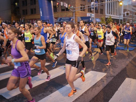 Runners start the Indianapolis Monumental Marathon in Downtown at the break of dawn on Nov. 3.