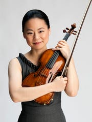 Midori made her professional debut as a violinist at