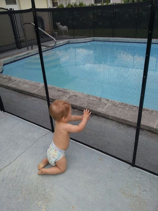 636232059389722455-Baby-at-fence.jpg