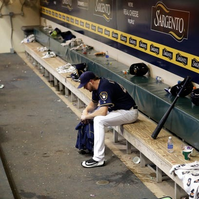 Brewers reliever Corey Knebel sits alone in the dugout