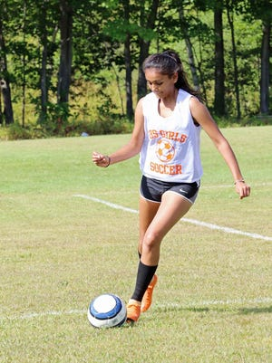 After one season of running cross country as a sophomore, Gardner High senior Khevana Patel switched sports and joined the girls' soccer team for the last two years of her high school athletic career.