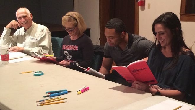 """Larry Pearlman (from left), Karen Covington-Yow, Elijah York, Perry Goeders and Mike Yow take part in a read-through of """"It's a Wonderful Life: A Live Radio Play,"""" to play at the Front Porch Theatre."""