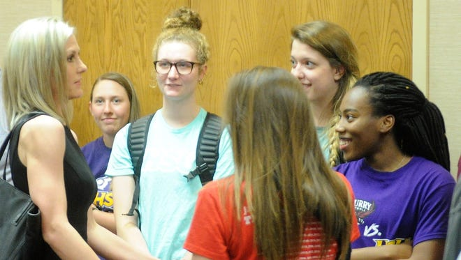 New Hardin-Simmons women's basketball coach Kendra Hassell, left, talks with current players before being announced as the new Cowgirls coach at the Moody Center on Monday, March 26, 2018.