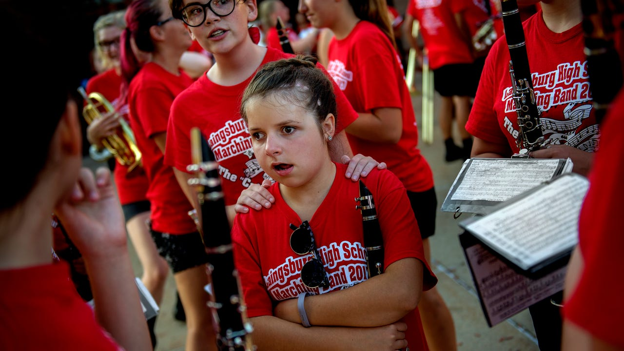 Laingsburg High School freshman Autumn Michels, who has been legally blind since age 4, and fellow senior band mate Rachael Steffens, are proving that kindness can exist and thrive in high school.