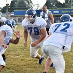 Chambersburg lineman Cory Martin (79)  practices with the Trojans on Tuesday at Bus Peters Field. Martin is trying to make an impact as a rookie senior.