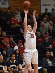 Marist College's Katharine Fogarty shoots against Quinnipiac University at the McCann Arena in the Town of Poughkepsie. Feb 12, 2015