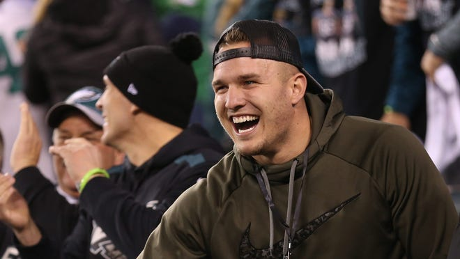 Los Angeles Angels outfielder Mike Trout (C) celebrates from the stands in the second quarter during the NFC Championship game after the Philadelphia Eagles score a touchdown against the Minnesota Vikings at Lincoln Financial Field.