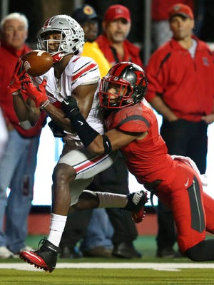 Rutgers defensive back Isaiah Wharton (11) breaks up a pass to Ohio State wide receiver Michael Thomas (3) during the first half of an NCAA college football game Saturday, Oct. 24, 2015, in Piscataway, N.J. (AP Photo/Mel Evans)