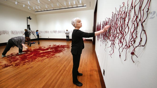 Luzene Hill, 68, was attacked while jogging at an Atlanta park 11 years ago. Her perpetrator used the strings on her jacket to strangler her into silence. Now, she's come to Eiteljorg Museum of American Indians and Western Art as one of its five 2015 contemporary Native American art fellows to install a piece consisting of 3,780 knots representing the number of unreported rapes of women in the U.S. within a 24-hour period.