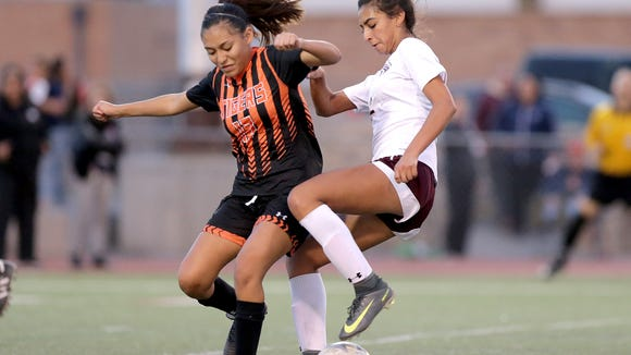 Alexa Barrera of Andress switches direction while covered by El Paso HIgh's Sofia Fileto Villanueva Tuesday night in their 5A regional quarterfinal at Irvin High School.