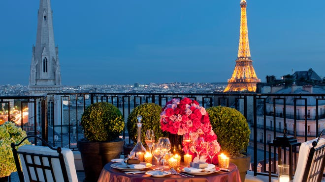 The penthouse balcony at the Four Seasons Hotel George V in Paris has a view of the Eiffel Tower.