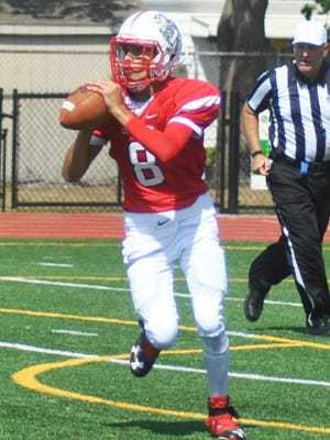 Elmwood Park senior Tyler Martinez, who played quarterback last season, will be moved outside to bolster the Crusaders' receiving corps.